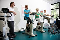 Patients during cardiovascular training with heart rate and pulse rate monitoring, physiotherapy, physical therapy in a neurological rehabilitation ce...
