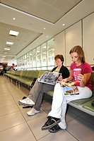Passengers seated in the waiting area in front of a boarding gate, BAA Heathrow International Airport, Terminal 4, London, England, United Kingdom, Eu...