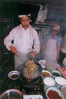 Photograph of a Chinese cook in action