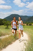Couple running on rural path