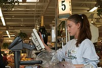 St  Clair Shores, Michigan - Anisa Bakiu, 18, works as a cashier at the Nino Salvaggio International Marketplace