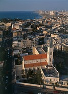 Aerial photograph of an old church in the modern city of Jaffa