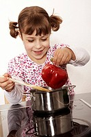 Six-year-old girl playing in the kitchen