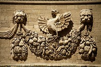 Dragons from the Borghese family coat of arms on the facade of the Hotel des Monnaies in Avignon, Provence, France, Europe