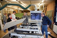 Specialist lecturer demonstrating a computer numerical control (CNC) milling machine, Master Craftman School of the Chamber of Small Industries and Sk...