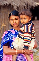 Indian women holding her daughter on her arms, India, Uttar Pradesh