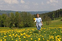 Child running through a dandelion meadow, Eurasburg, Upper Bavaria, Bavaria, Germany, Europe