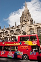 Tour bus passing The University Church of Saint Mary The Virgin on Oxford's High Street