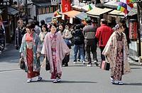 Young people in kimonos in the old town walking to the Kiyomizu-dera temple, Kyoto, Japan, Asia