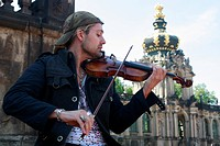 Star violinist David Garrett playing in the Zwinger museum in Dresden, Saxony, Germany, Europe