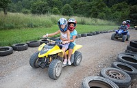 Children riding a quad bike, Hesse, Germany, Europe