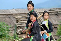 Three young women with traditional hairstyle and dress of the Basha minority, the smallest minority in China, Basha, Guizhou, China, Asia