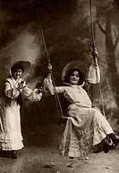 Girls on swings, historical photo around 1908