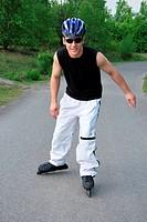 In-line skater wearing helmet and sunglasses