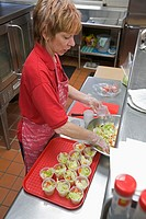 Dearborn, Michigan - Debra Sabaugh making salads in the cafeteria at Lindbergh Elementary School