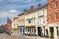 The Black Swan Hotel and shops in the Market Place at Devizes, Wiltshire, England, UK