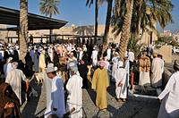 Omani man in traditional dress, livestock or animal market at Nizwa, Hajar al Gharbi Mountains, Al Dakhliyah region, Sultanate of Oman, Arabia, Middle...