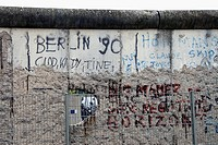 Berlin, Germany. A remaining section of the Berlin Wall preserved as a historical display at the Topography of Terror open-air exhibition, Niederkirch...