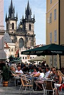Cafe in Old Town with Tyn church in background, Prague, Czech Republic
