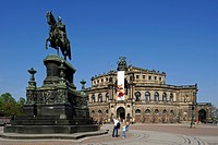 Semperoper Opera house with flags and Koenig Johann memorial, Theaterplatz square, Dresden, Free State of Saxony, Germany, Europe