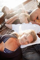 two couples relaxing on deck