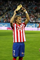 Diego Forlan, football player of the Atletico de Madrid, offers to his interest the European Golden Boot obtained in the season 2008-09, trophy to the...