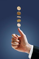 Hand tossing a coin