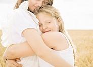 Girls hugging in wheat field