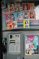 public phone box with pictures of naked women, United Kingdom, London