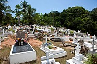 Colorful cemetery in the south-west of Mahe Island, Seychelles, Indian Ocean, Africa