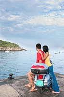 Couple with Moped on Vacation