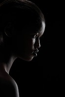 Profile of woman on black background