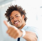 Businessman showing success sign