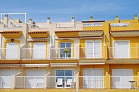 For rent, town houses, balconies, yellow, empty, chairs, Isla Plana, Puerto de Mazzaron, Costa Calida, Murcia, Spain, Europe
