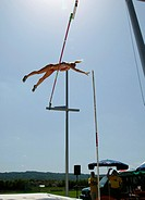 motionsequence pole vault, athlete jumping over the bar