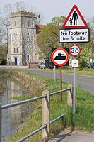Traffic signs against All Saints Church, Chitterne, Wiltshire, England, United Kingdom