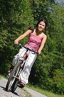 young darkhaired girl on a mountainbike