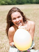 woman laughing with balloon