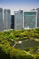 Office buildings at a pond in the Hama Rykiu Garden in Shiodome District, Tokyo City, Japan, Asia