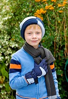 6-year-old boy wearing a hat, scarf and gloves