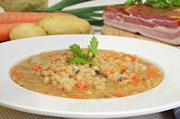 White bean soup, stew, with ingredients, celery, leek, potatoes, carrots, bacon