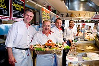 Chefs with a seafood platter, Gosch delicatessen store, Alte Bootshalle, old boat hall, List, Sylt Island, North Frisia, Schleswig-Holstein, Germany, ...