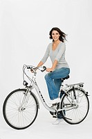 Woman on a bike, right posture to prevent back ache
