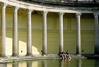 Schloss Albrechtsberg castle, classical columnade with pond, two young men cooling their feet in the water, Dresden, Saxony, Germany, Europe