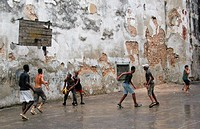 teenagers playing basketball in a backyard in the old town, Cuba, La Habana