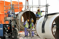 Workers on the construction site of Pearl GTL, Gas to Liquid, where the Shell company are constructing until 2010 the world-wide largest refinery for ...