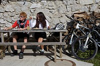 Mountainbike riders, male and female, taking a break at Karwendelhaus, alpine club house, Scharnitz, Tyrol, Austria, Europe