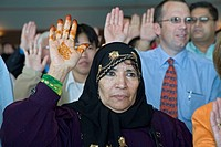 A woman from Yemen is one of 600 immigrants sworn in as new citizens of the United States, Detroit, Michigan, USA