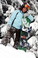 young girl doing snowboard, France, Alps