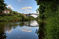 Ironbridge crossing the river Severn, first iron bridge worldwide, built by Abraham Darby in 1779, in Telford, Shropshire, England, Great Britain, Eur...